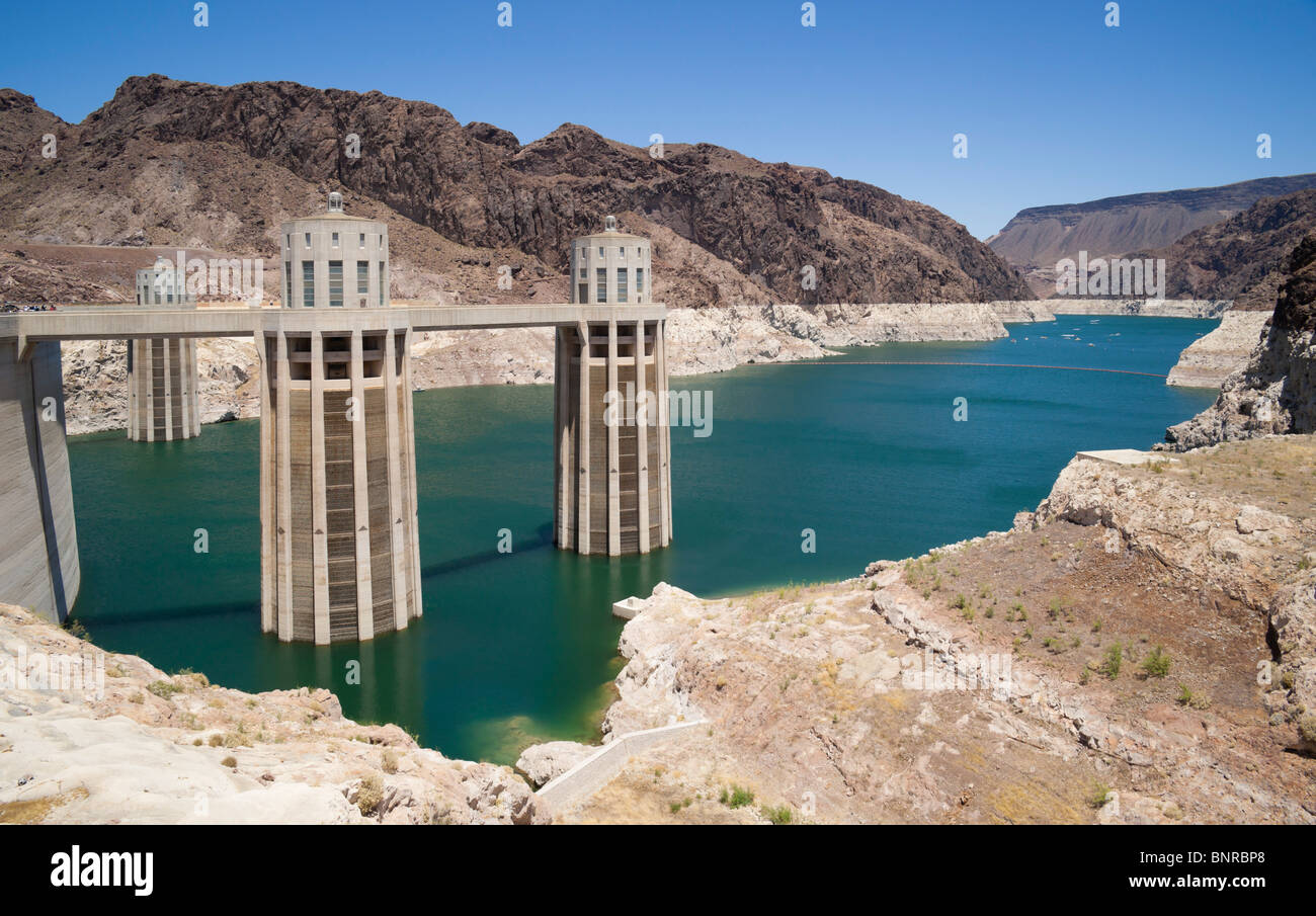 USA Nevada/Arizona border - Hoover Dam on the Colorado River, Lake Mead. Penstock feed towers exposed by low water Stock Photo