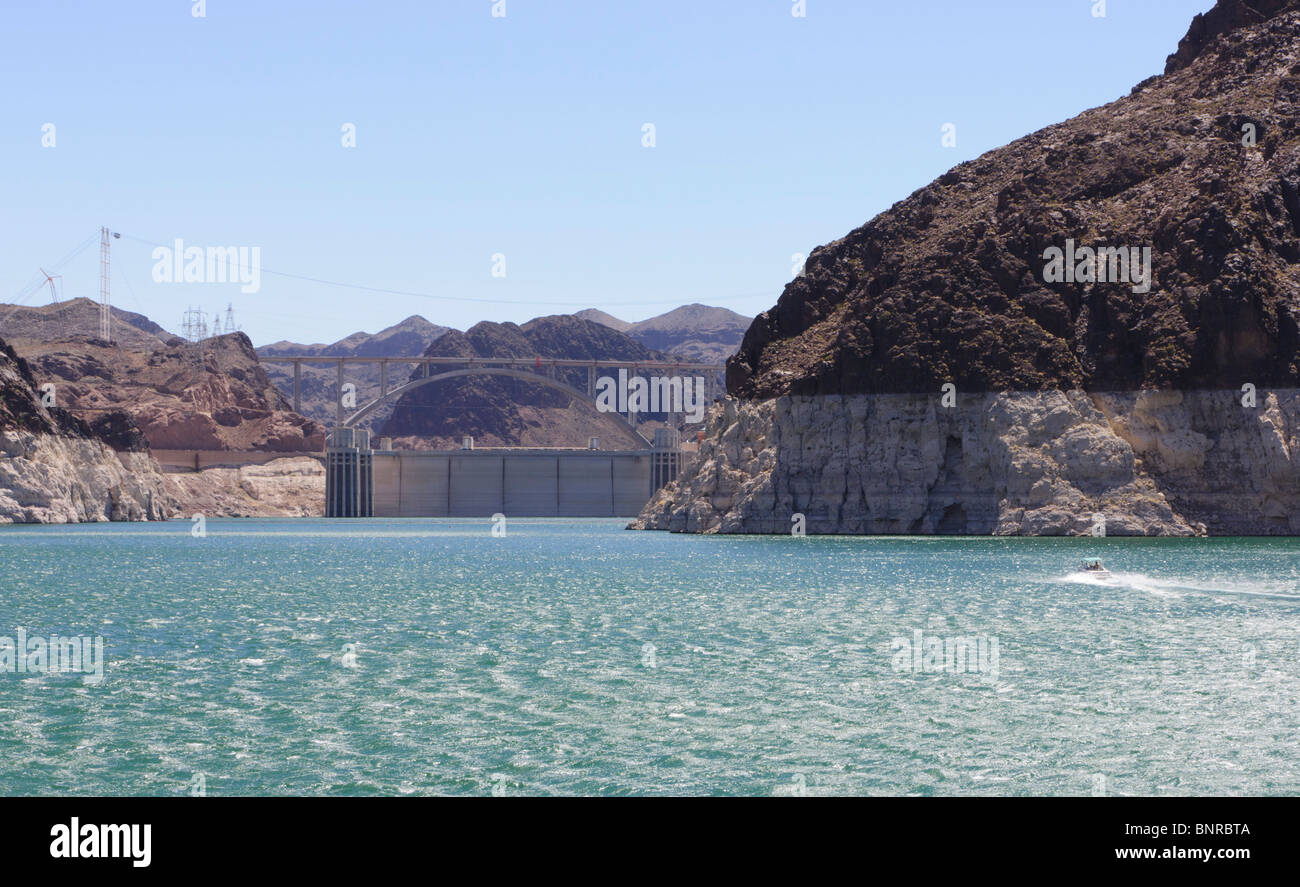 USA Nevada - Hoover Dam seen from Lake Mead cruise. Light rock zone is high water mark. Lack of rain - low water Stock Photo
