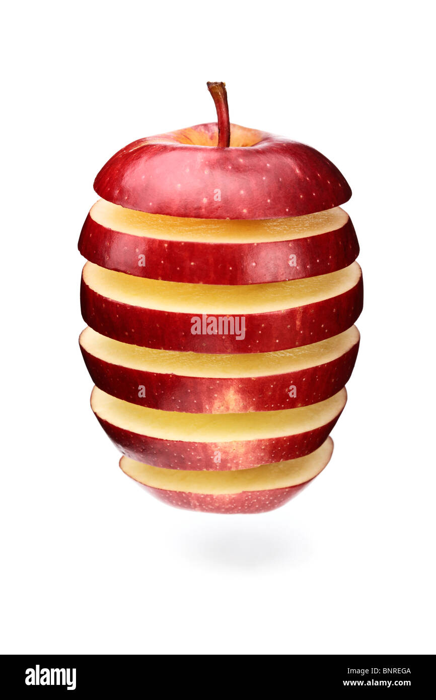 A red apple sliced in layers and re-arranged with gaps (isolated against white) - Stock Image