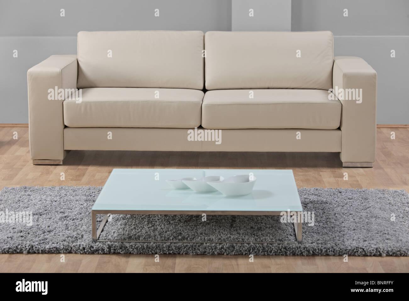 A leather white sofa - Stock Image