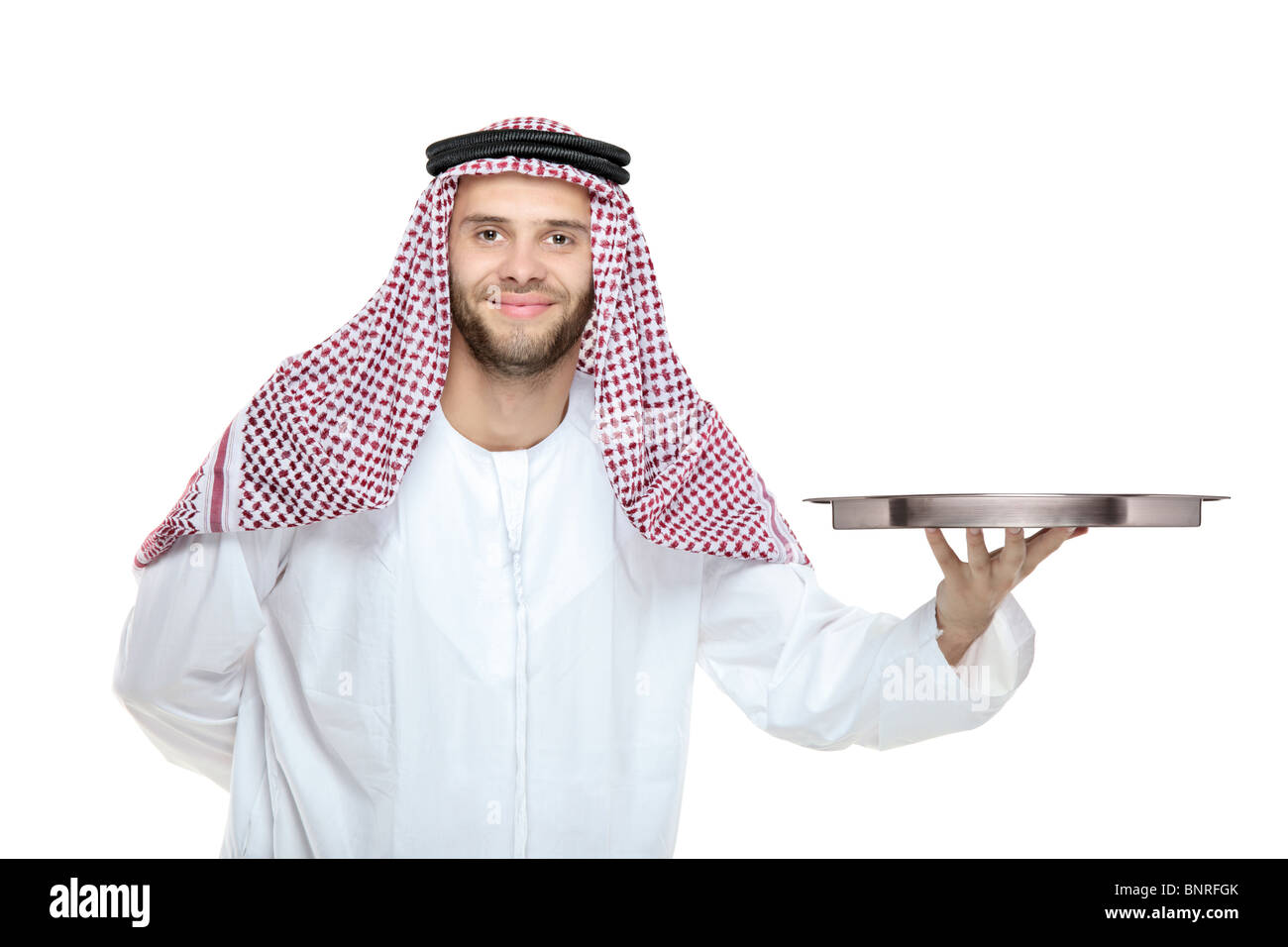 An arab person holding a tray Stock Photo