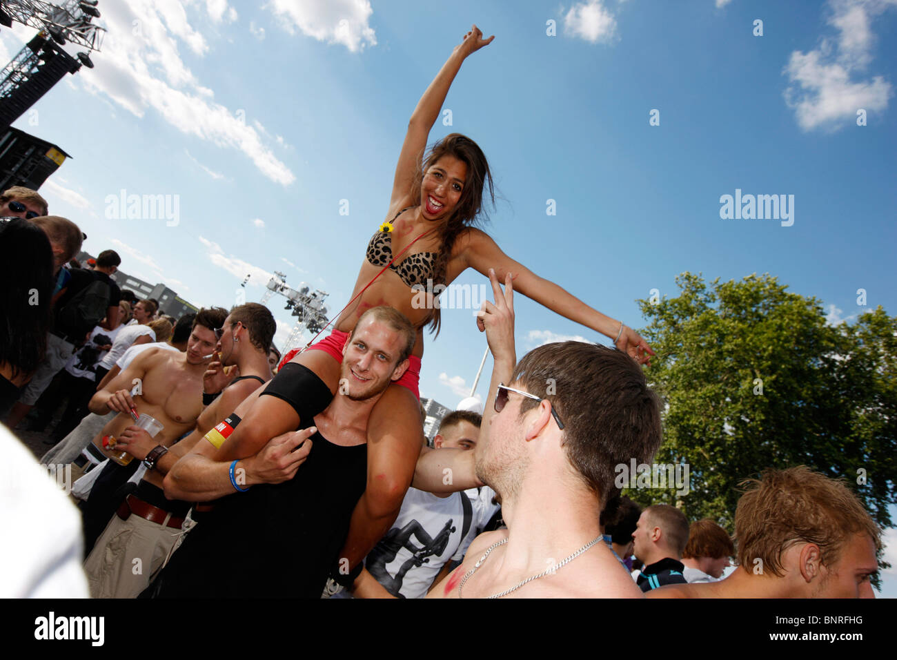 Loveparade in Duisburg, Germany. Biggest techno music festival in the world. Hundred thousand of people come to - Stock Image