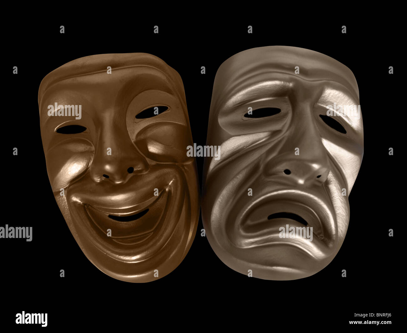 Theatrical comedy and tragedy masks, isolated on black. - Stock Image