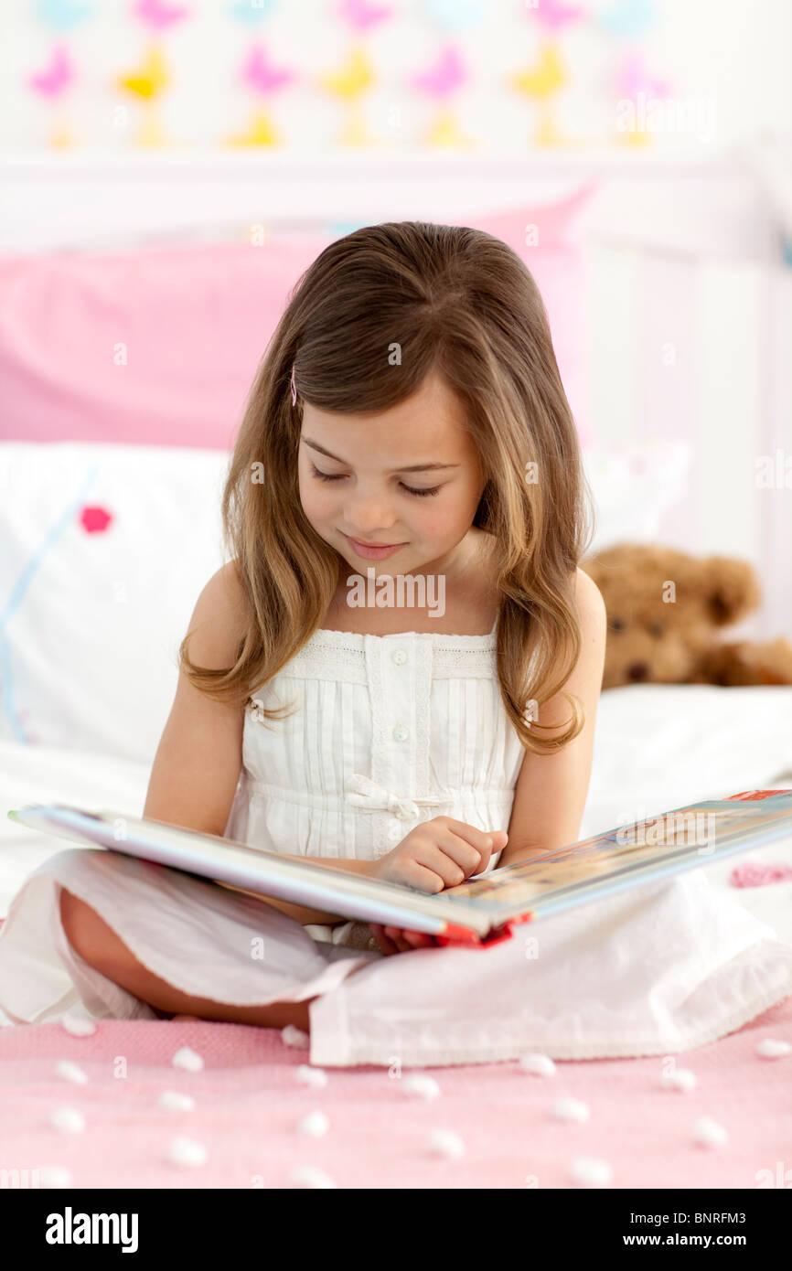 Little Girl Sitting On Bed Stock Photos & Little Girl