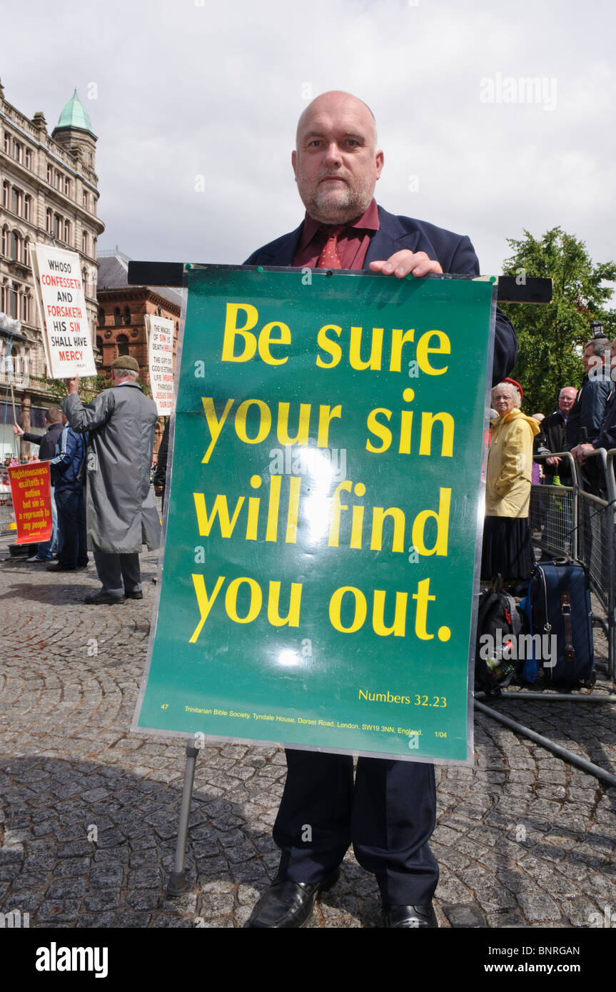"""Man holds a banner """"Be sure your sin will find you out"""" (Numbers 32:23) Stock Photo"""