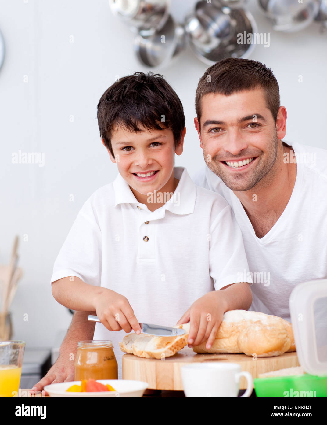 Smiling Father And Son Preparing A Toast Stock Photo