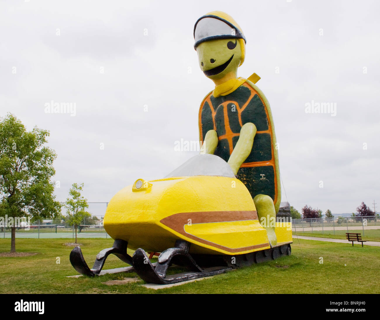 Giant Turtle Riding Snowmobile in Bottineau North Dakota Stock Photo
