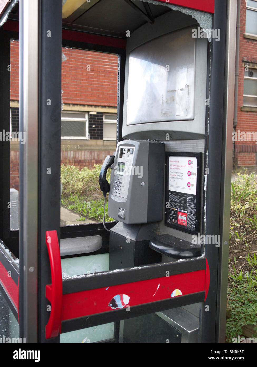 Vandalized telephone kiosk, Chadderton,Lancashire, UK - Stock Image