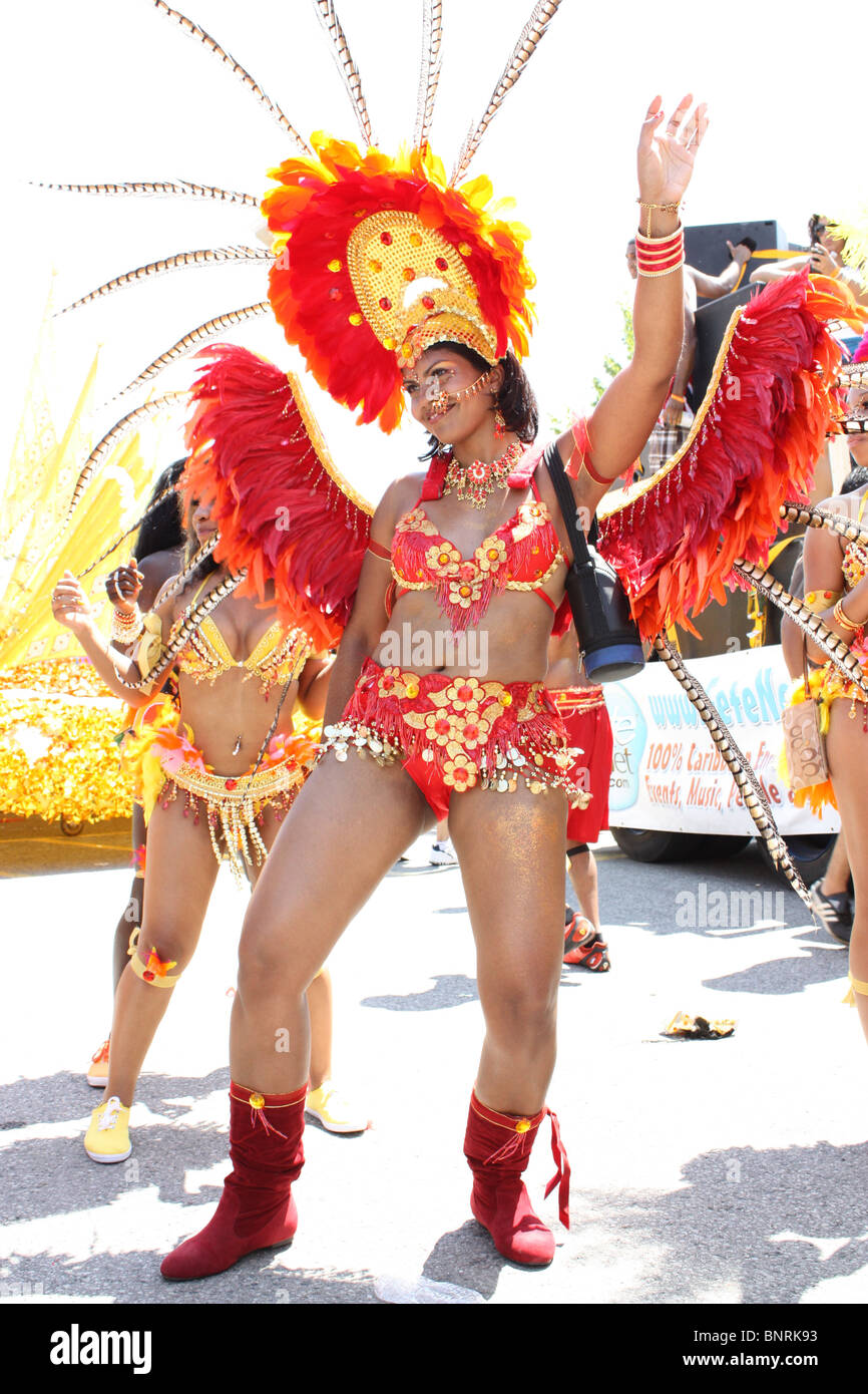 red orange costumed woman dancing outdoor festival - Stock Image