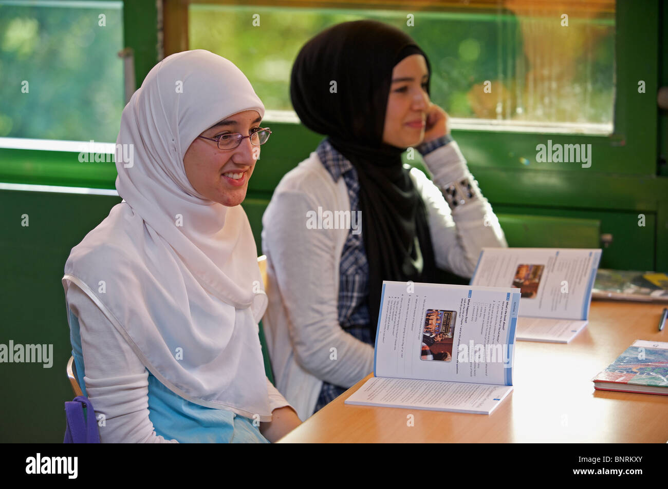 German schoolgirls of Turkish decent in an English lesson - Stock Image