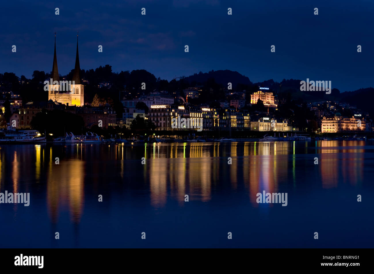 Europe, Switzerland, Lucerne lakefront dusk, st leodegar church - Stock Image