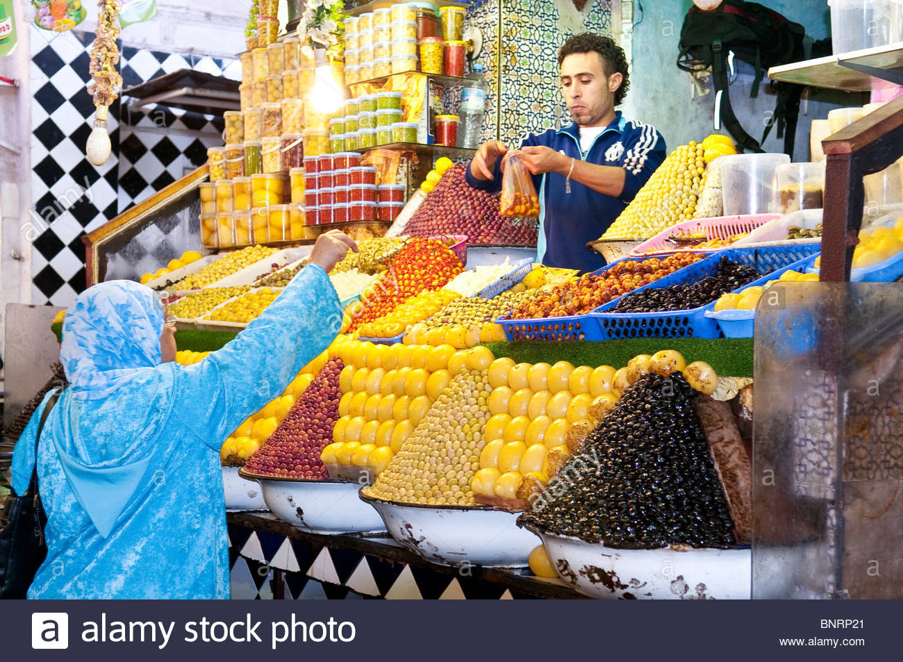 Olives and Preserved Lemons For Sale in the Meknes Morocco Market Stock Photo