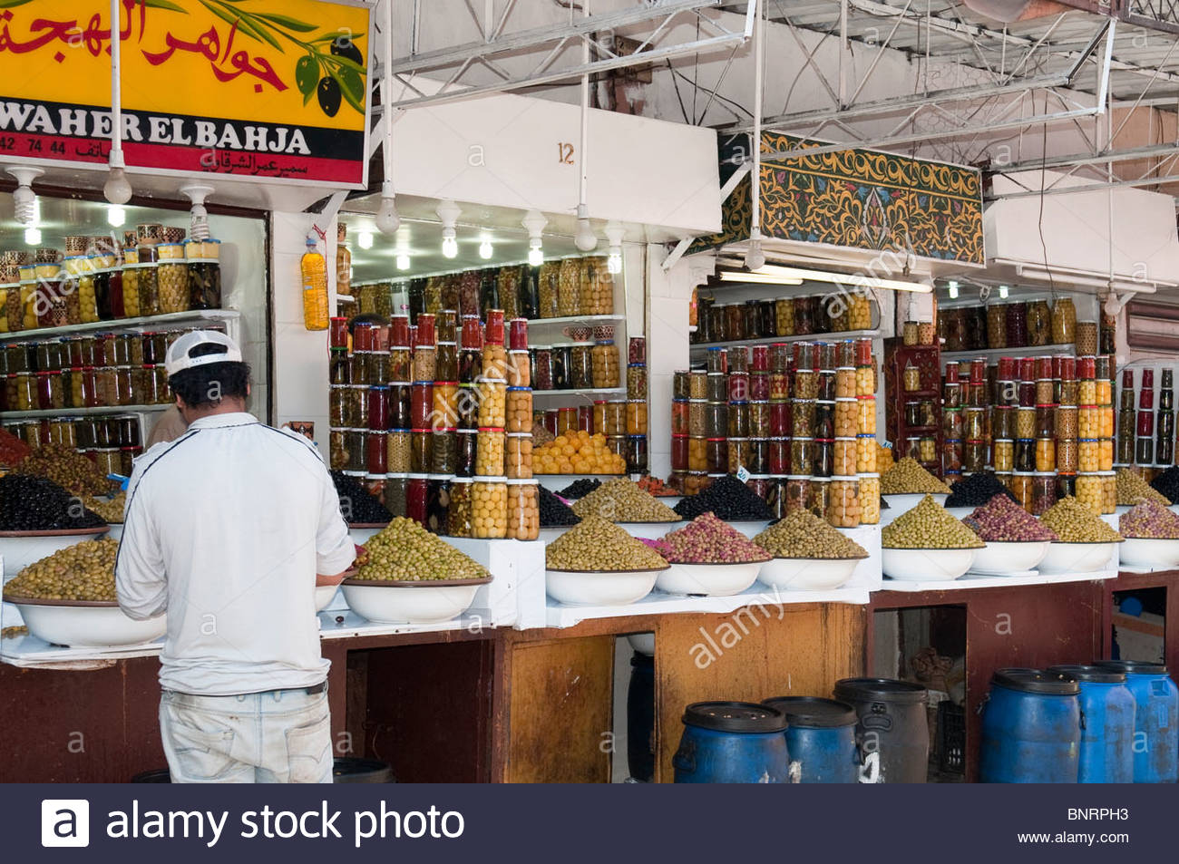 Olives and Preserved Lemons For Sale in a Moroccan Market - Stock Image