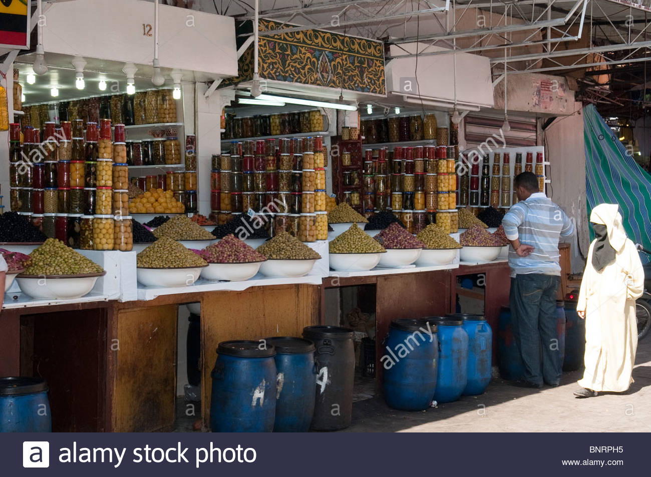 Olives and Preserved Lemons For Sale in the Meknes Morocco Market - Stock Image