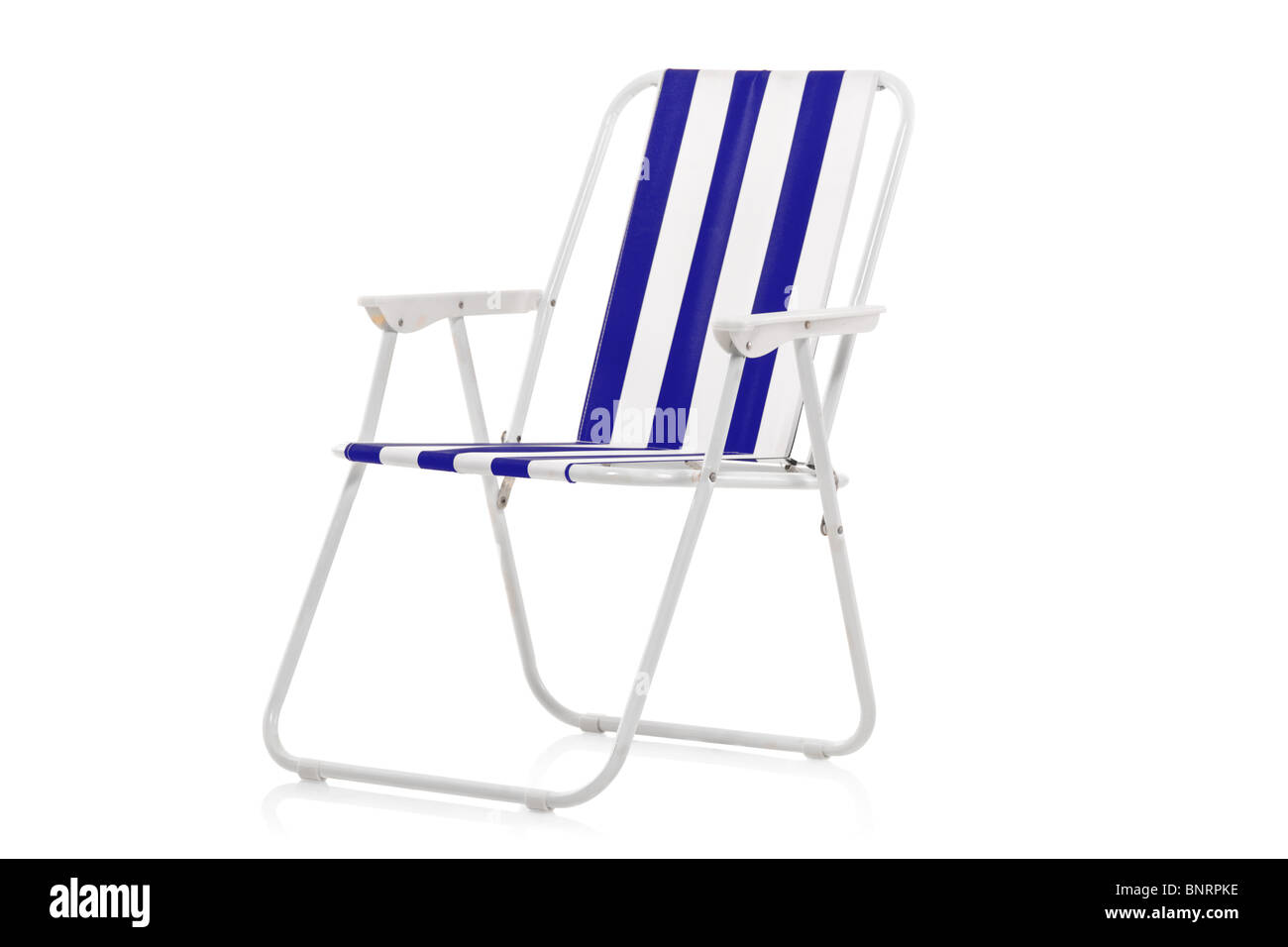 Blue and white striped beach chair - Stock Image