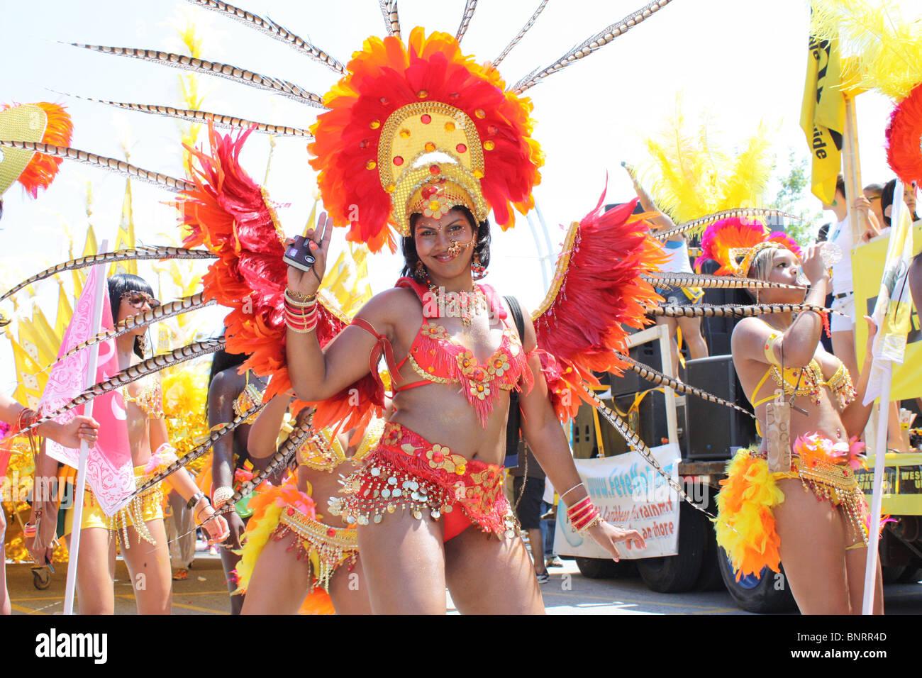 costumed black woman dancing outdoor festival - Stock Image
