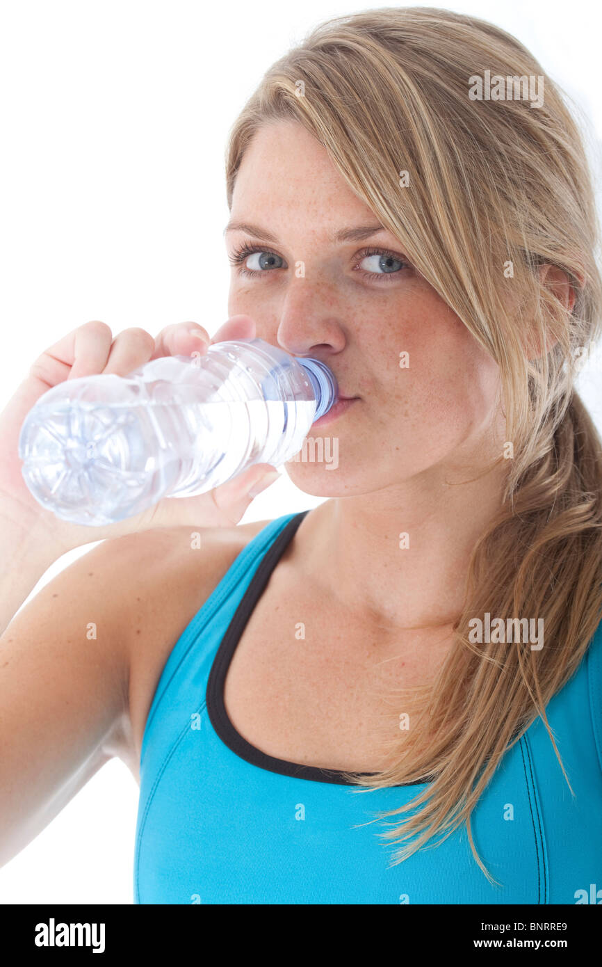 female athlete drinking water after working out - Stock Image