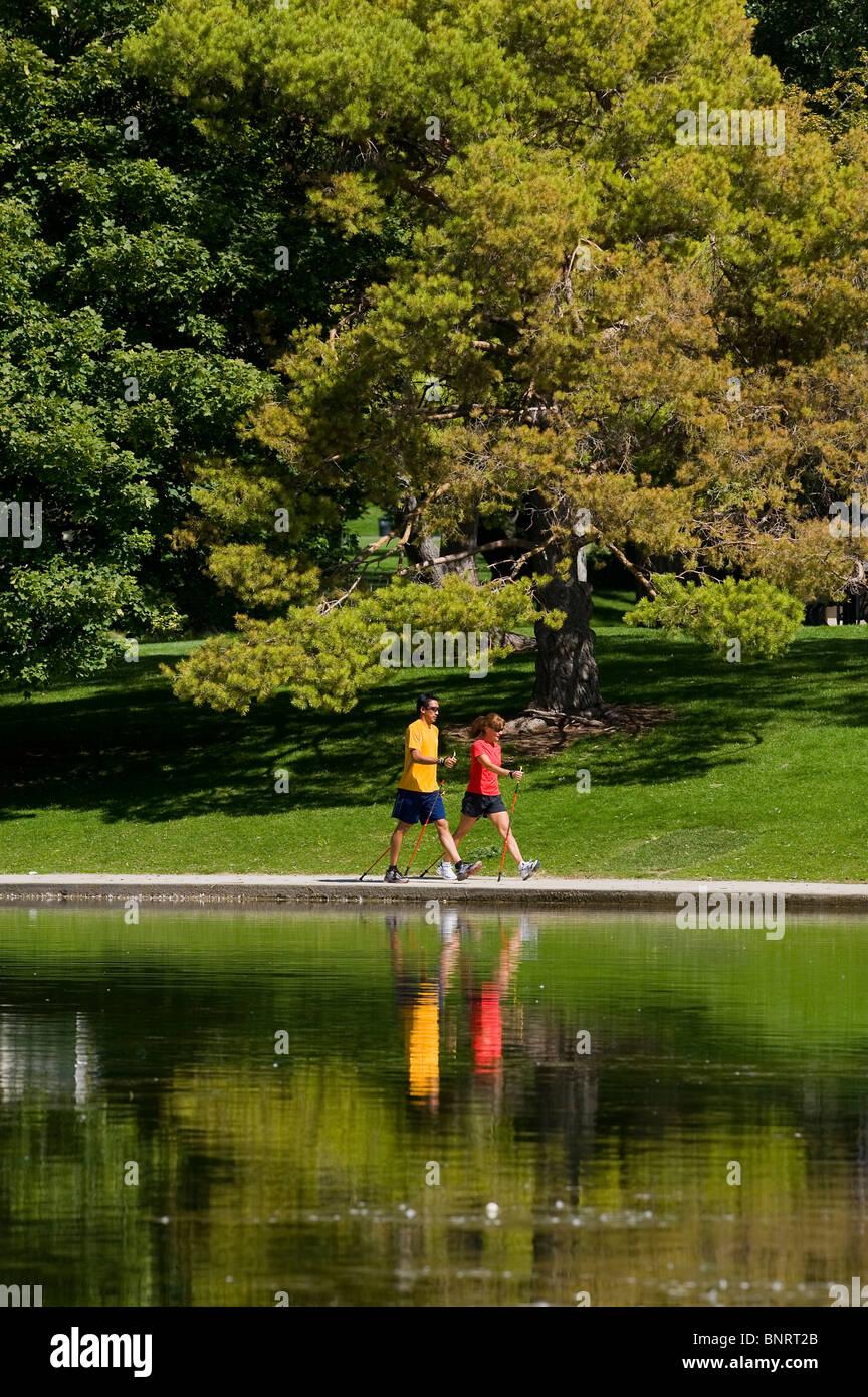 Man and woman walking in park, Salt Lake City, Utah. - Stock Image