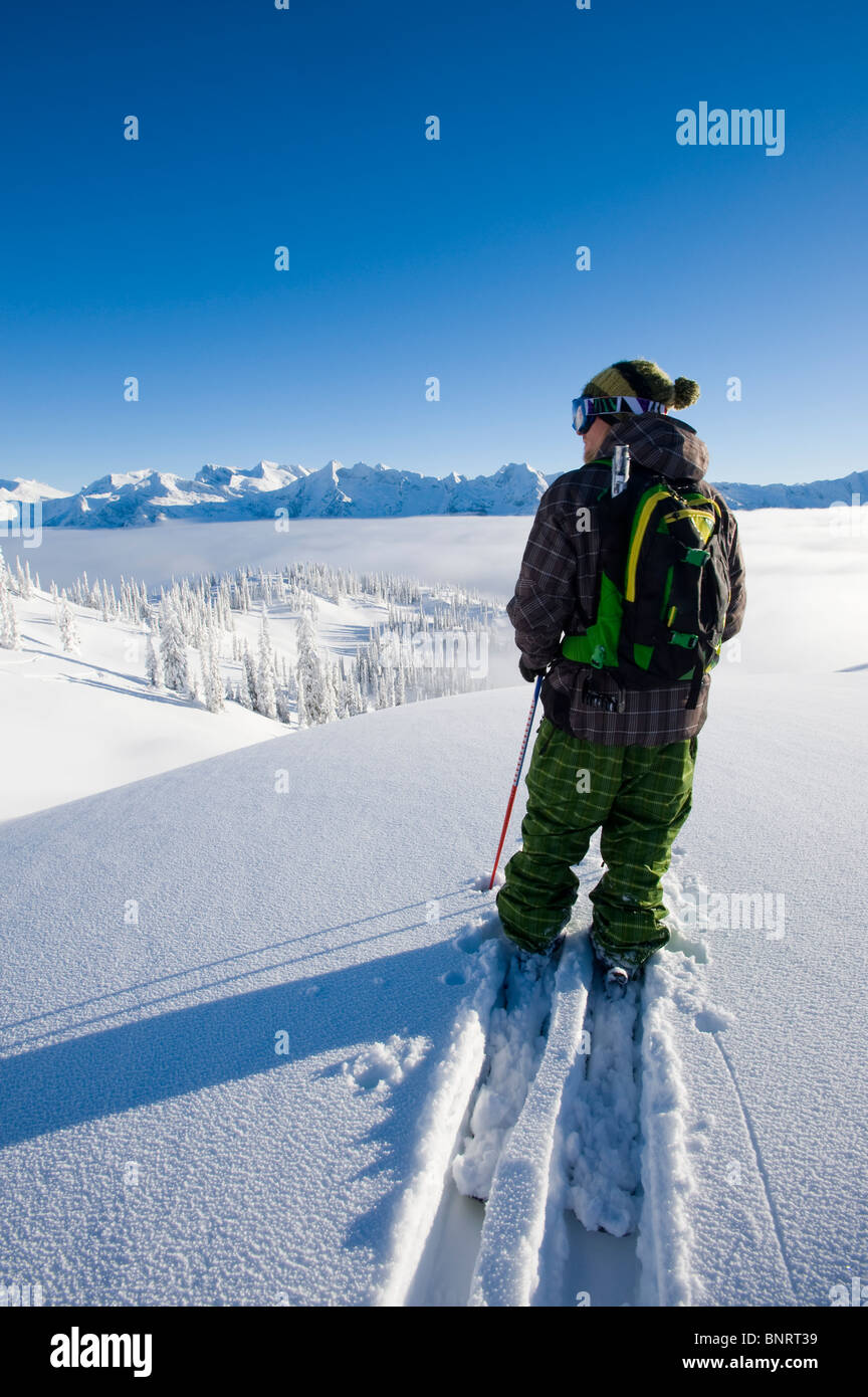 Man traversing on skis, BC, Canada. - Stock Image