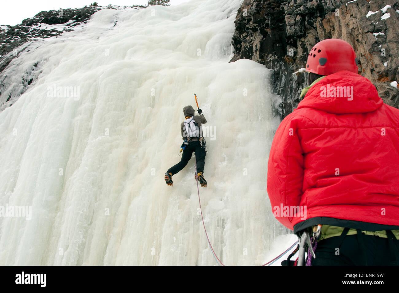 A man ice climbing. - Stock Image