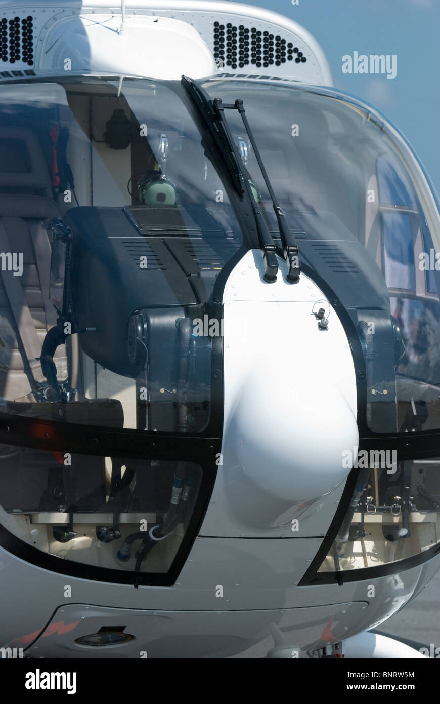Font detail with cockpit of white helicopter - Stock Image
