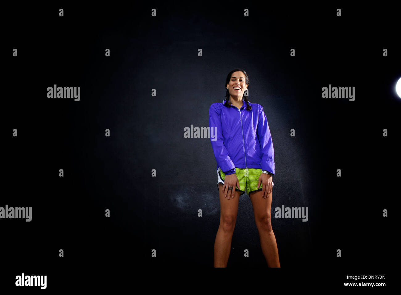 Female runner laughs in San Diego. - Stock Image