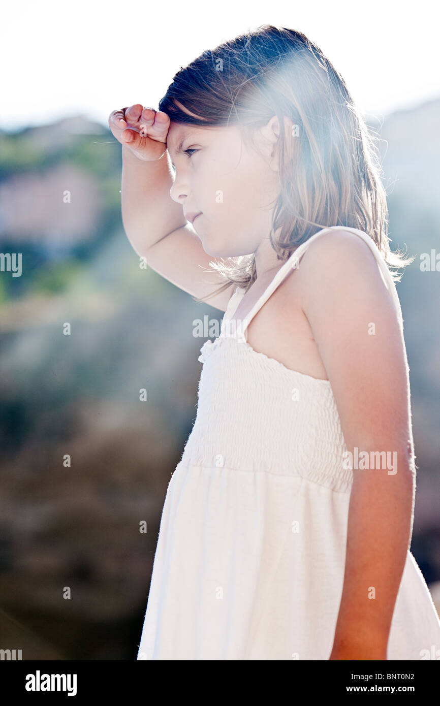 Shot of a Cute Young Blonde Haired Child Looking off Camera - Stock Image