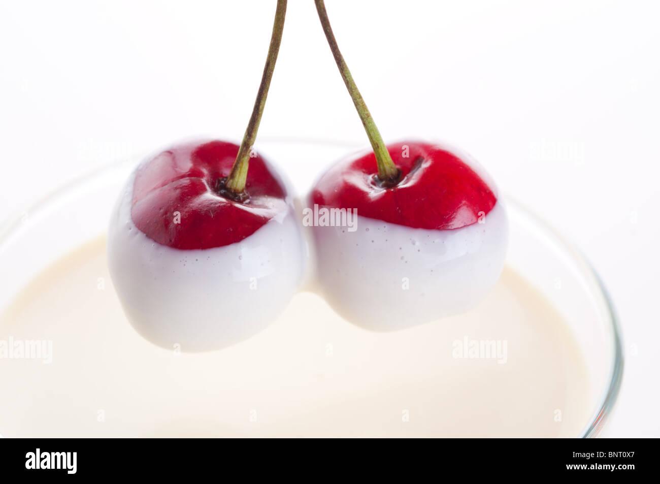 Sweet cherry in a cream. - Stock Image