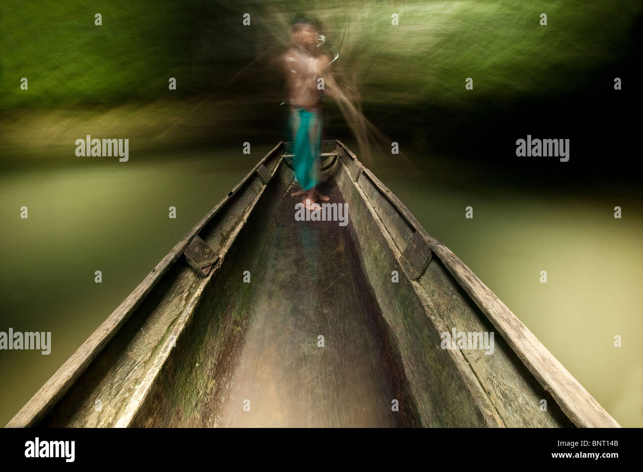 Embera indian man in his boat on Mogue river in the Darien province, Republic of Panama. Stock Photo