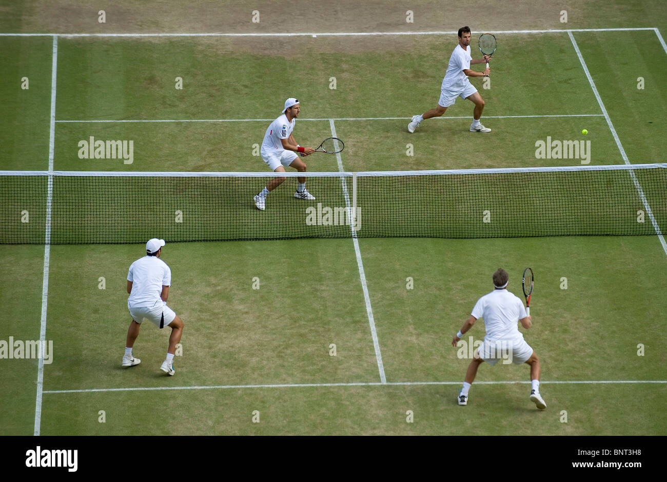 Action from the Men's Doubles Final during the Wimbledon Tennis Championships 2010 - Stock Image