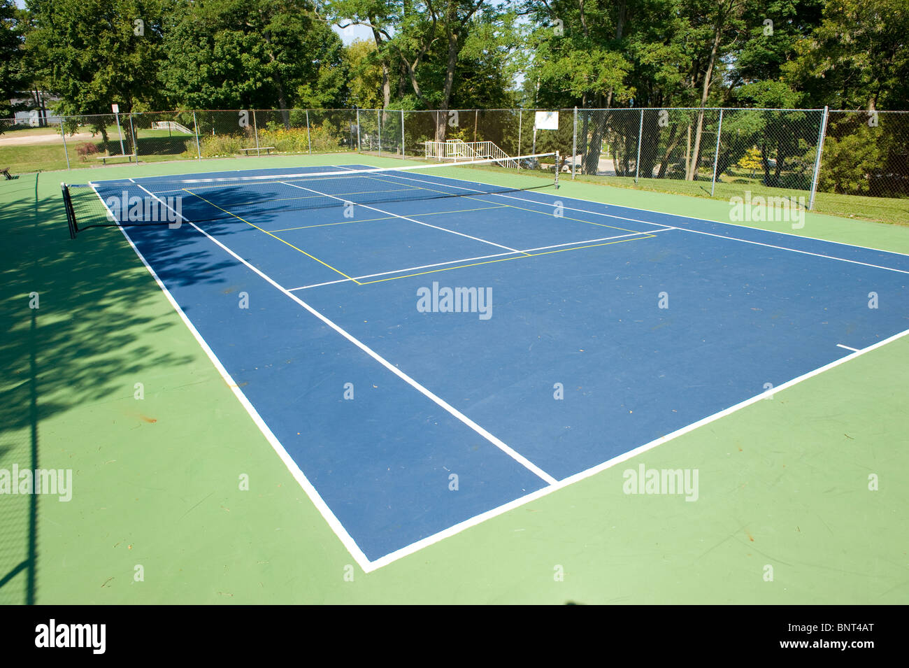 Empty tennis court with Pickleball lines painted on it - Stock Image