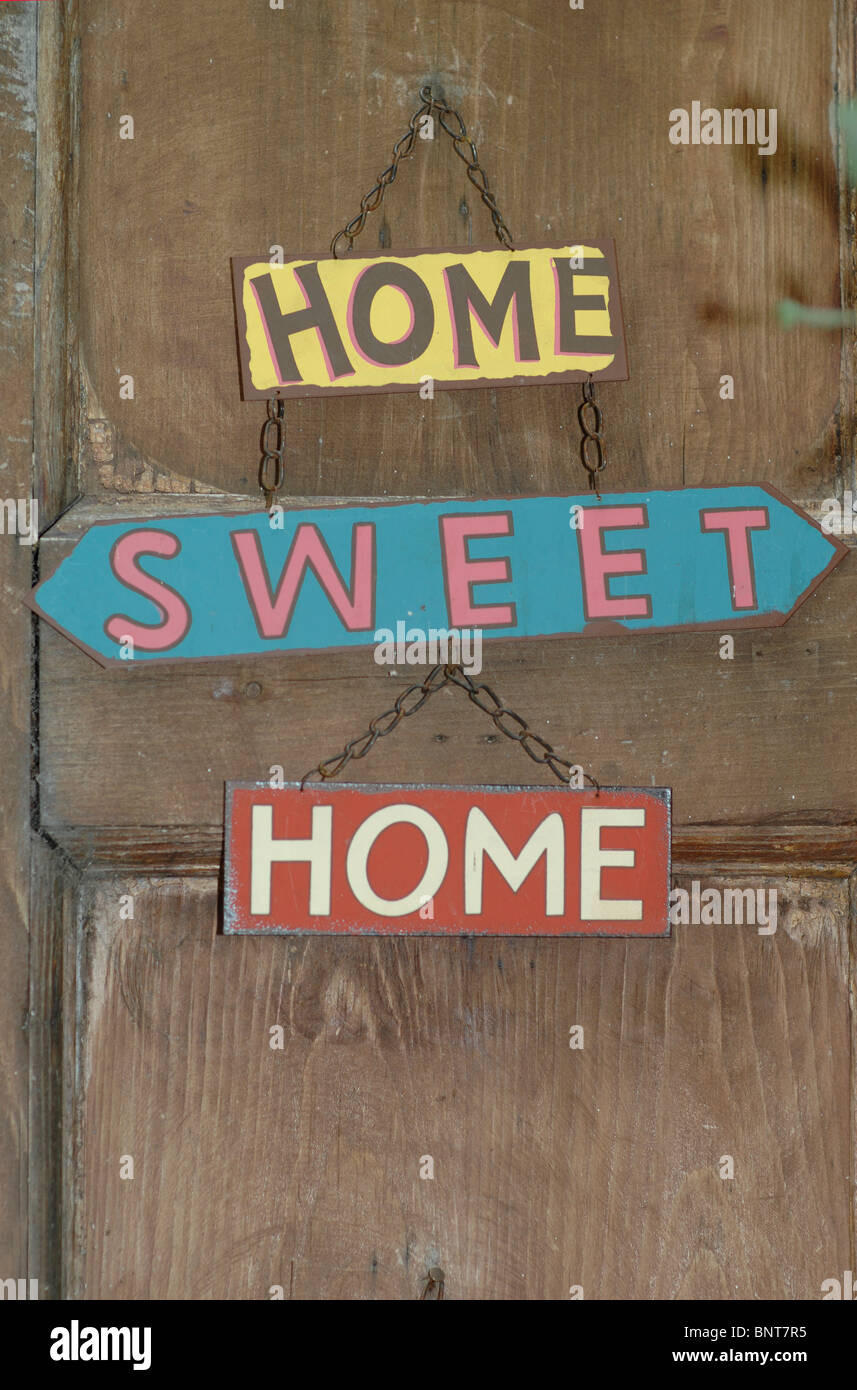 'Home Sweet Home' sign on a door - Stock Image