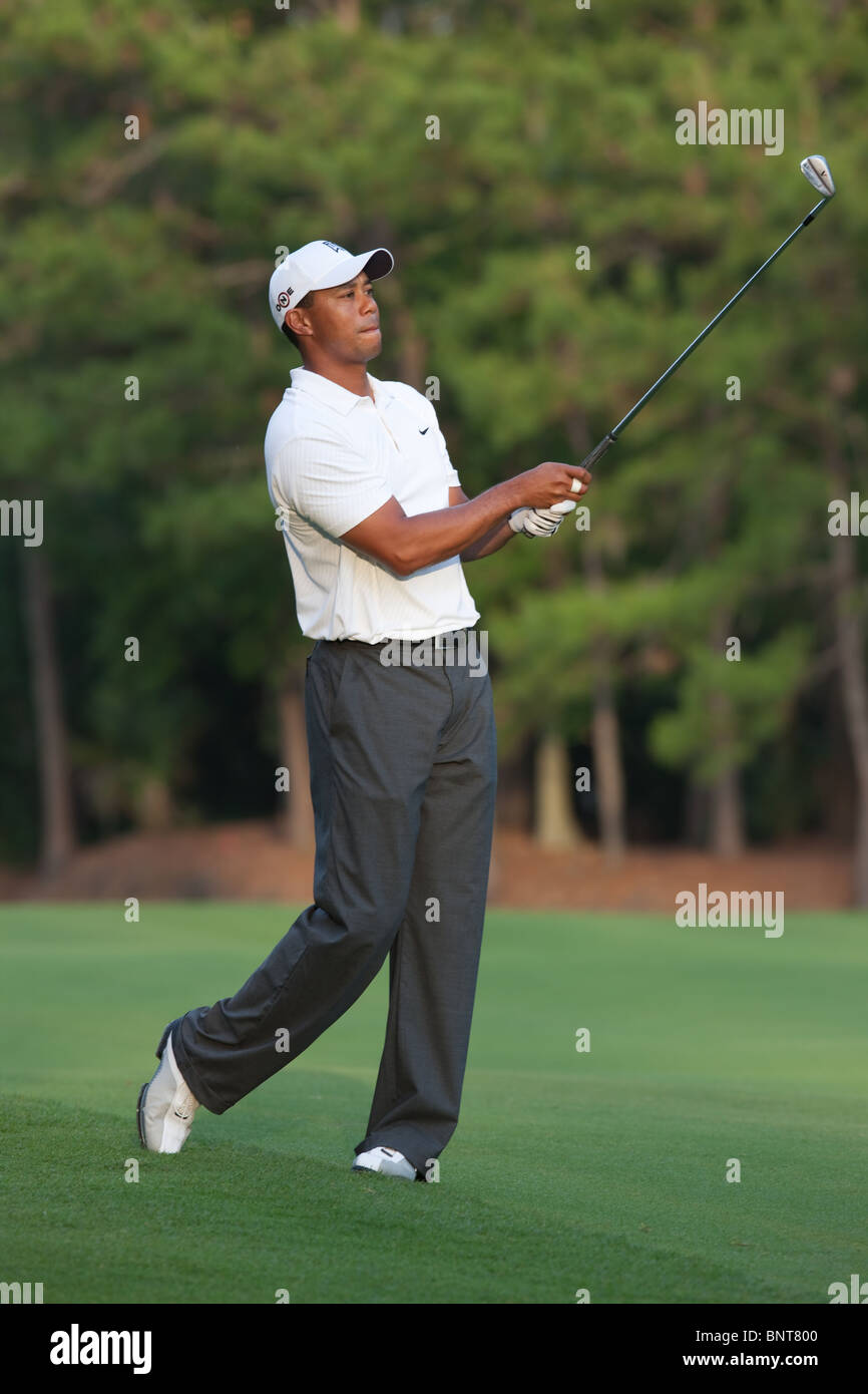 T:iger Woods hits his approach shot on the par 4 10th hole during a practice round at 2009 Players Championship. - Stock Image