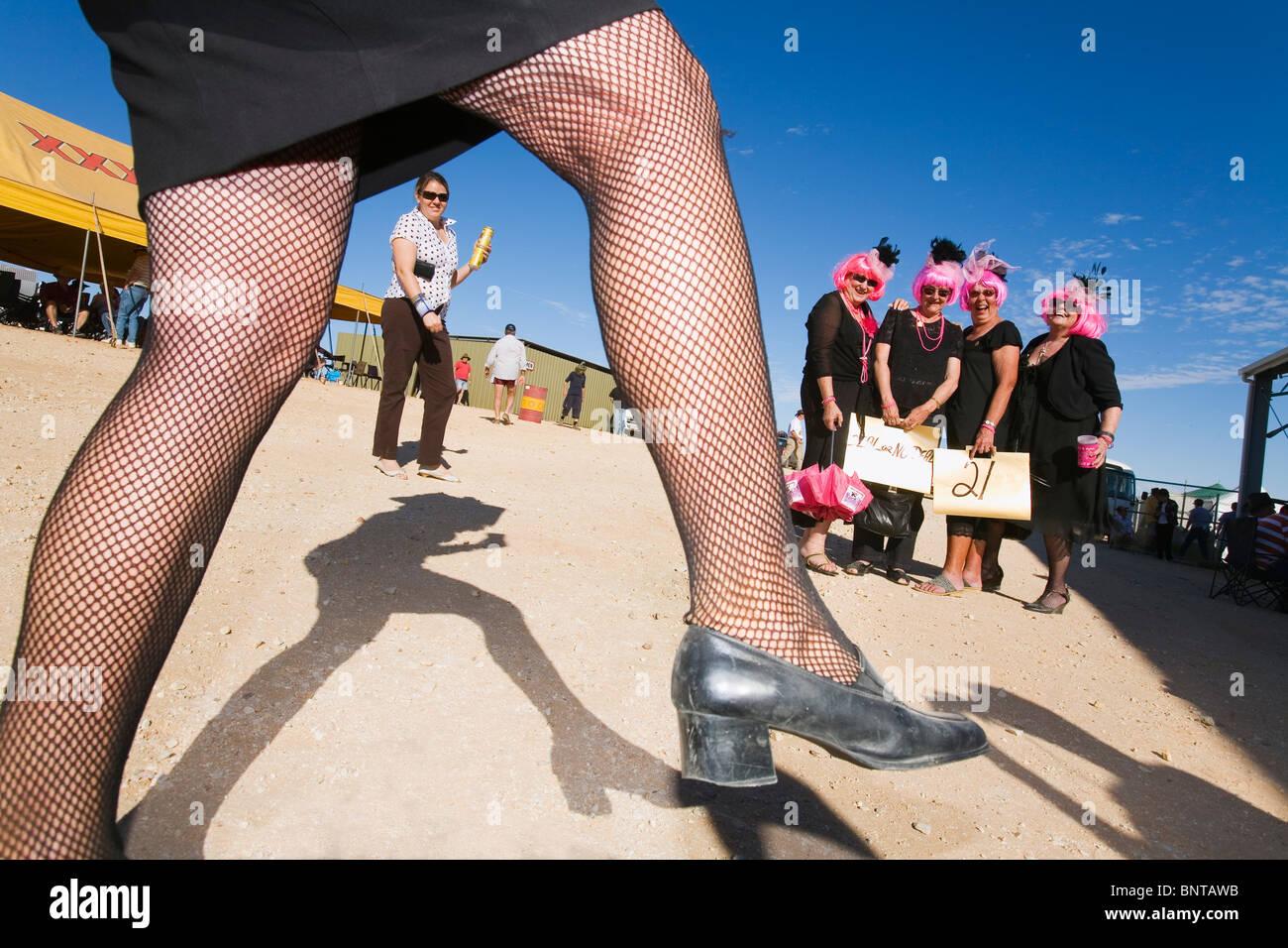 Race goers in costume dress for the fun of the Birdsville Races.  Birdsville, Queensland, AUSTRALIA. - Stock Image
