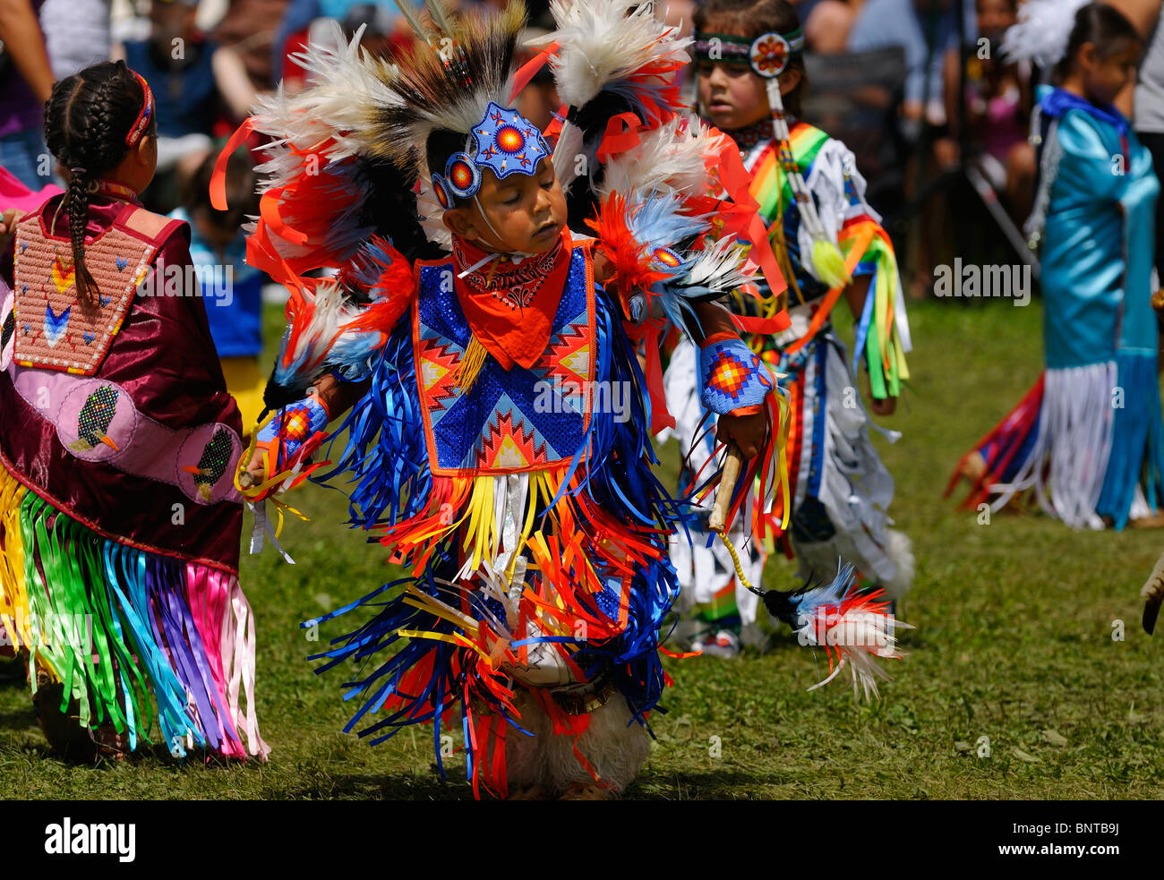 Young boy Native Indian Feather Dancer in tiny tots competition at Six Nations Reserve Pow Wow Grand River Ontario - Stock Image