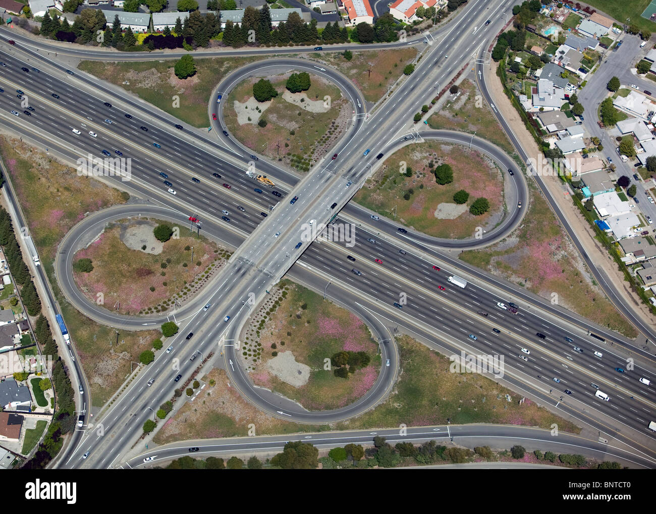 aerial view above clover leaf freeway interchange interstate I-880 Alameda county California - Stock Image