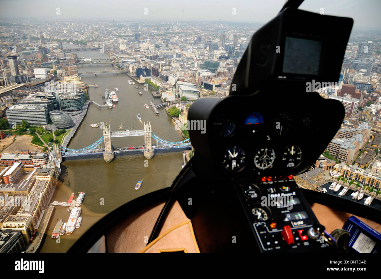 Aerial shot London Bridge from a Robinson R44 helicopter cockpit . - Stock Image