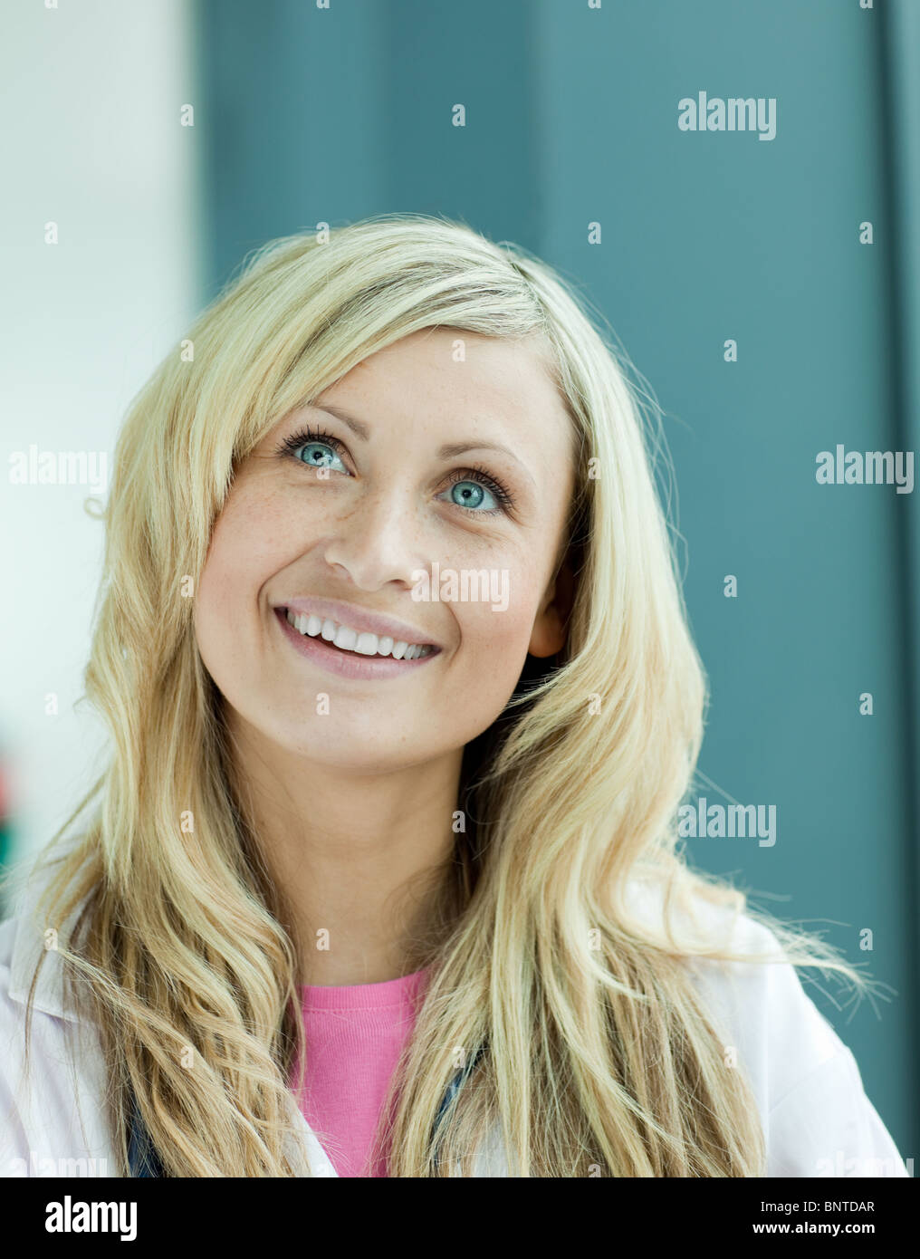 Radiant female doctor looking at the camera - Stock Image