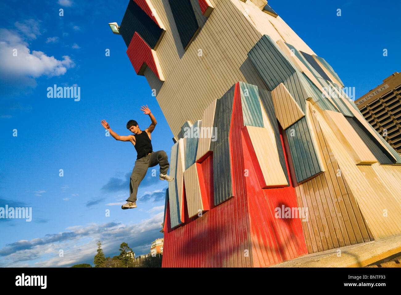 A man practises the urban sport of parkour (free running) in Adelaide, South Australia, AUSTRALIA. - Stock Image
