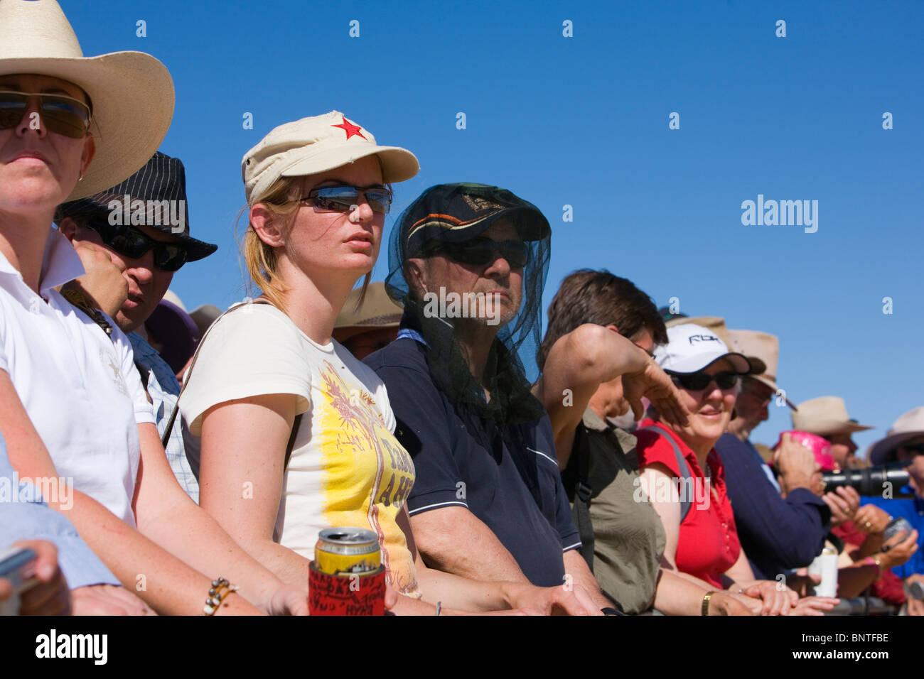 Spectators watch the horse racing action during the Birdsville races.  Birdsville, Queensland, AUSTRALIA. - Stock Image