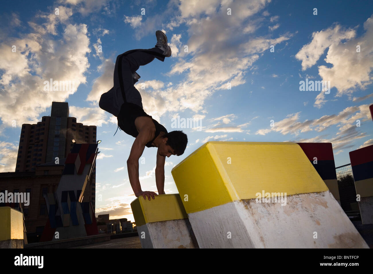 A teenager practises the urban sport of parkour (free running) in Adelaide, South Australia, AUSTRALIA. - Stock Image