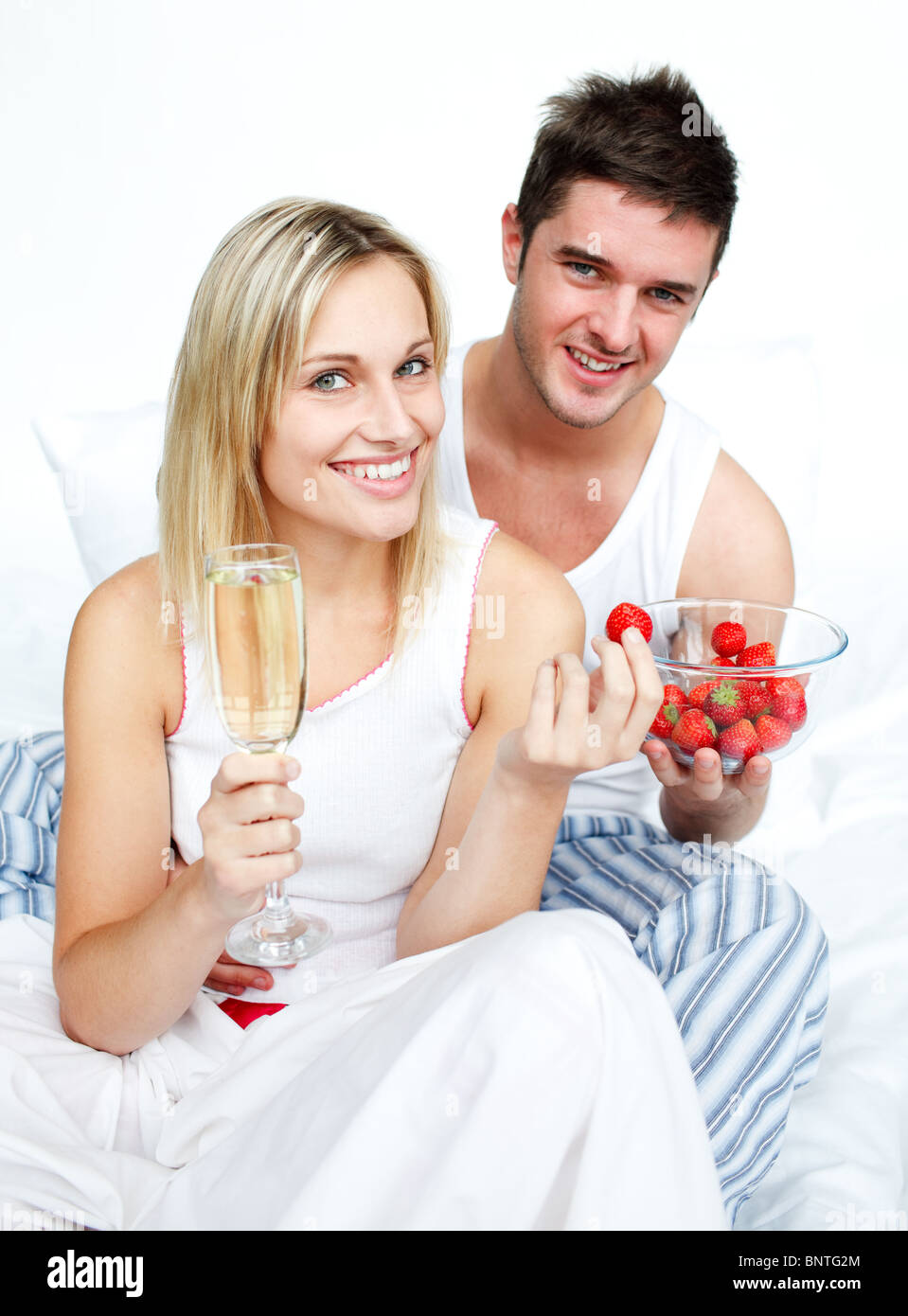 Loves eating strawberries and drinking champagne - Stock Image