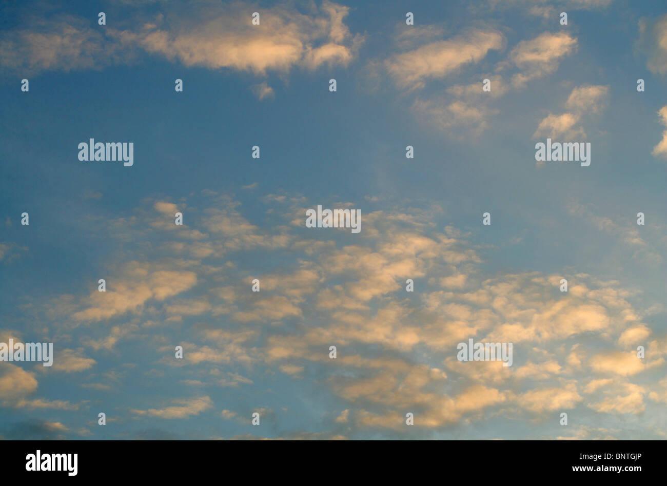 Fluffy White Cumulus Clouds in a Blue Sky - Stock Image