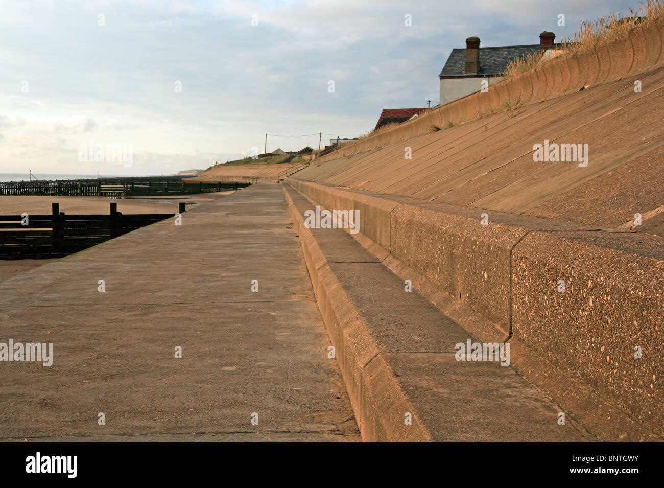 Substantial concrete sea wall for coast protection at Bacton on sea, Norfolk, England, United Kingdom. - Stock Image