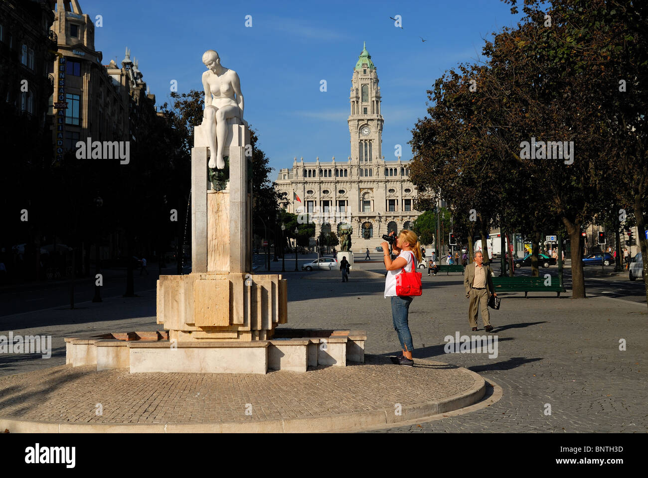 Young lady tourist photographing the sights in Oporto, Portugal. - Stock Image
