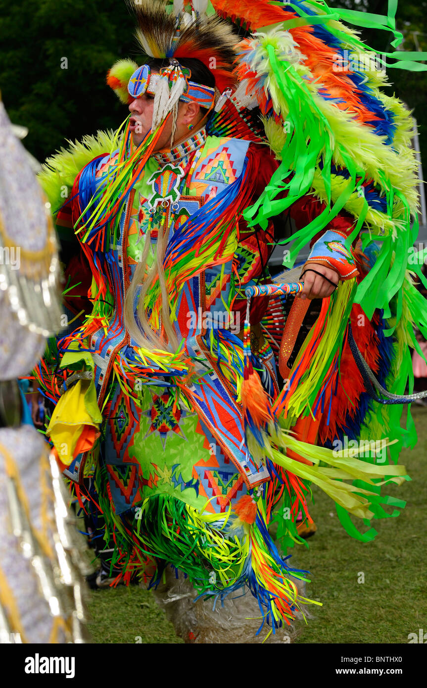 Native Indian Fancy Dancer and jingle dress at Grand Entry for a Six Nations Reserve Pow Wow Grand River Ontario - Stock Image