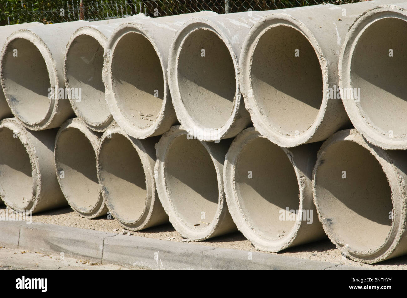 Concrete sewer pipes for construction project in Kassiopi on the Greek Mediterranean island of Corfu Greece GR - Stock Image