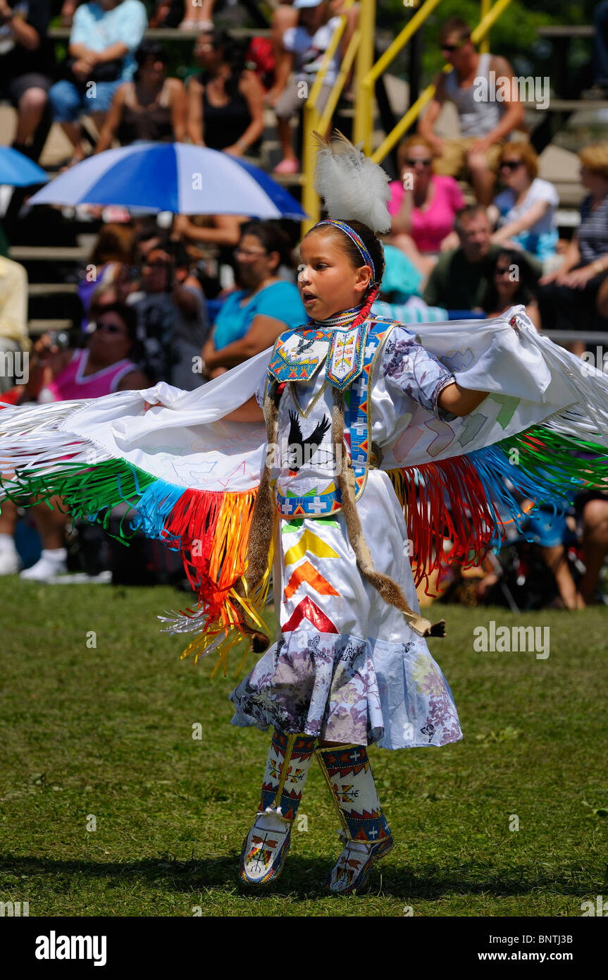 Young Native Indian girl on toes in the Fancy Shawl Dance competition at the Six Nations Reserve Pow Wow Grand River - Stock Image
