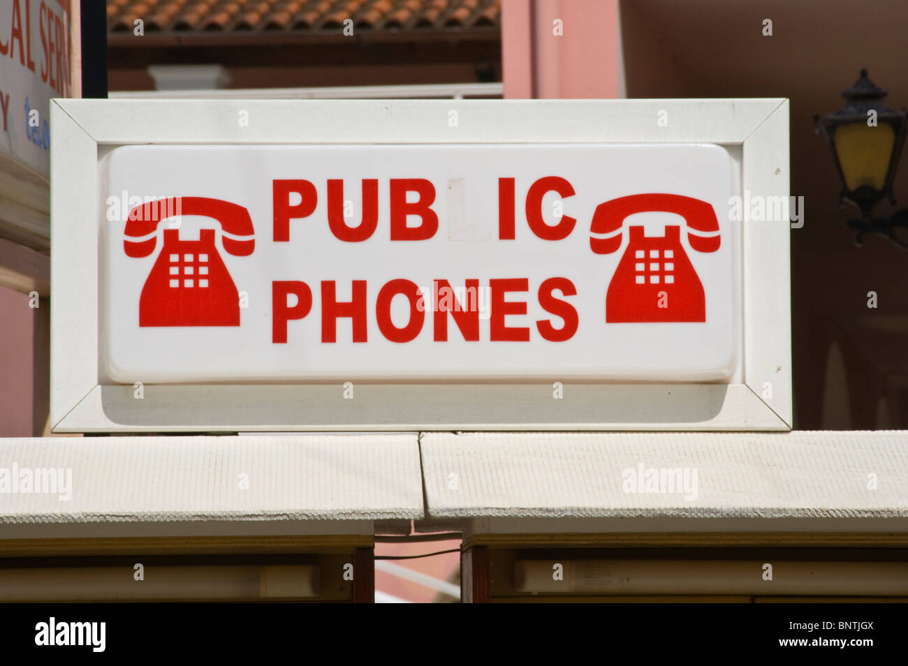 funny signs Vandalised public 'pubic' phones in Kassiopi on the Greek Mediterranean island of Corfu Greece - Stock Image