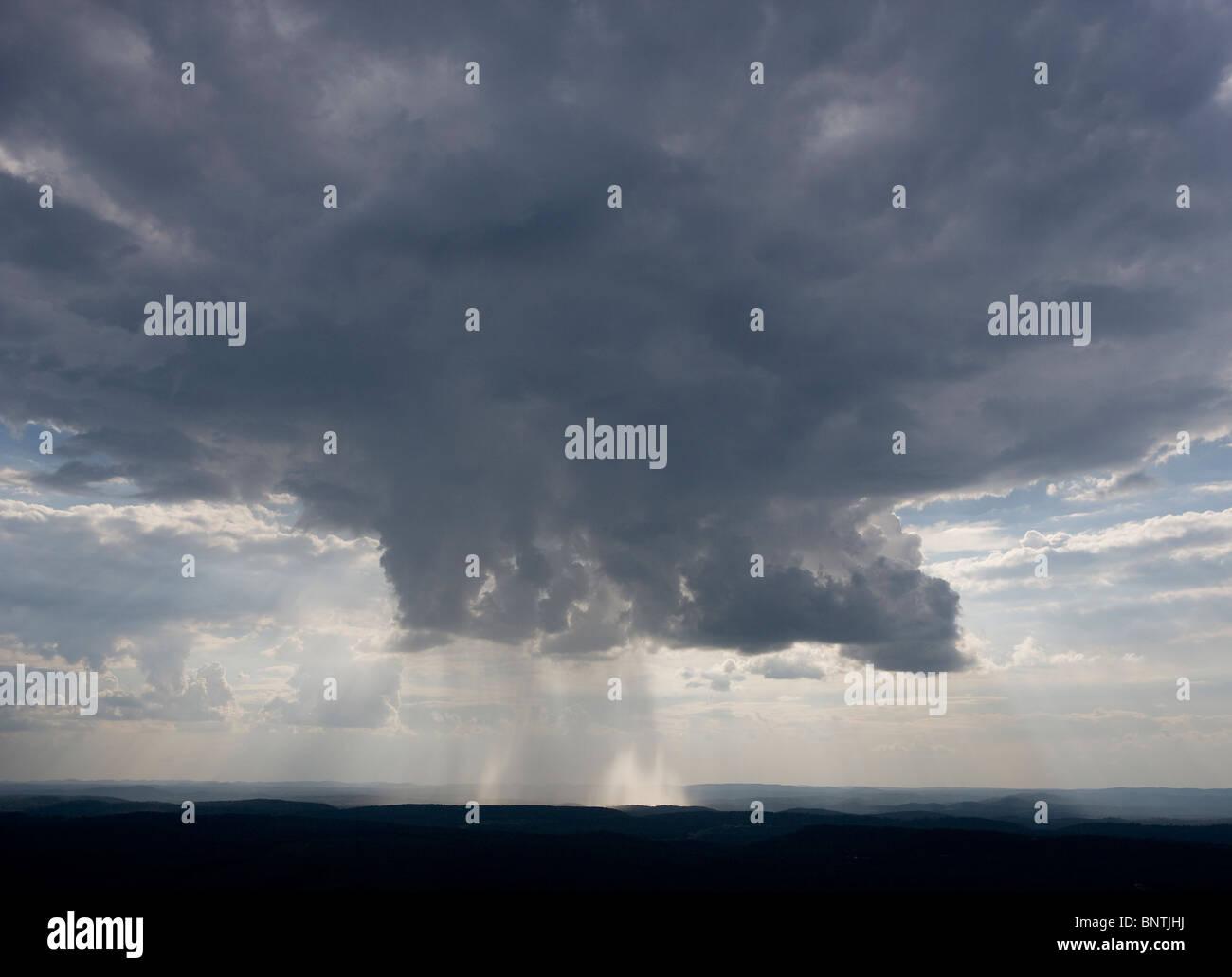 aerial view above rain pouring from cumulonimbus cloud Georgia - Stock Image